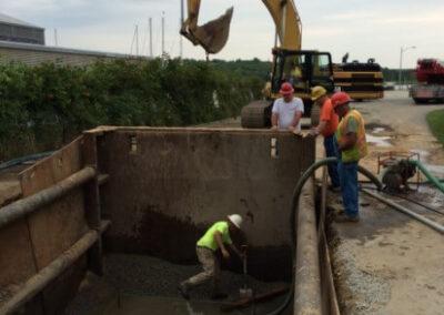 excavator at job site clearing stormsafe vault installation location