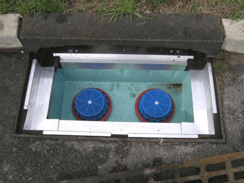 fabco industries stormbasin cartridge based stormwater filter system plastic basin in curb