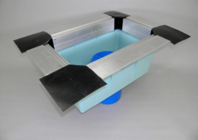 fabco industries stormbasin cartridge based stormwater filter system plastic basin rubber corners