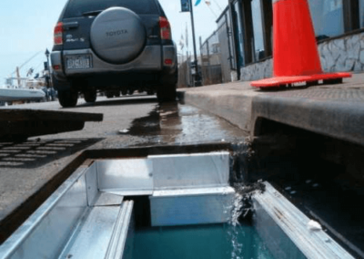 fabco industries stormbasin cartridge based stormwater filter system plastic basin water flowing
