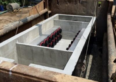 fabco industries stormsafe cartridge vault stormwater filter system 32 cartridge configuration installation being lowered