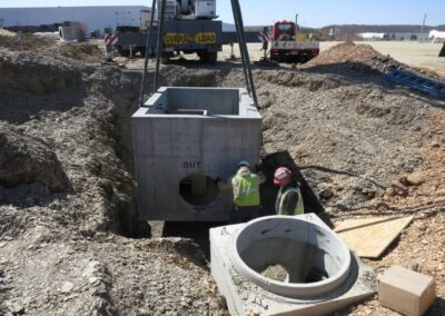 fabco industries stormsafe cartridge vault stormwater filter system being moved open top
