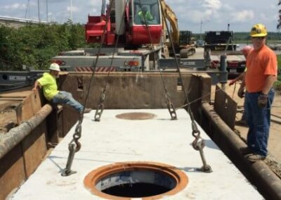 fabco industries stormsafe cartridge vault stormwater filter system installation top being lowered 2