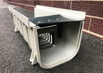 fabco industries trench drain stormwater filter system trash and debris capture device entrance close up