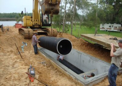 lowering fabco industries helix filter into stormwater filter vault with crane