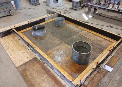 precast stormwater filtration vault base construction in progress