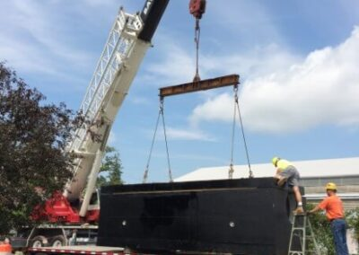 stormsafe cartridge vault being moved off truck with crane